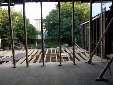 Framing the floor on the back half of the Downtown Luxury Slum