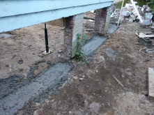 More concrete footings so the house won't shift when the sandy soil washes away