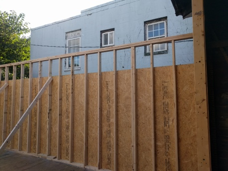 New walls on the back half of the downtown luxury slum