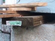 Wood shims helping to level the floor