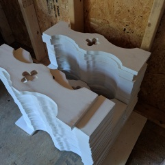 Stack of newly cut porch rail pieces