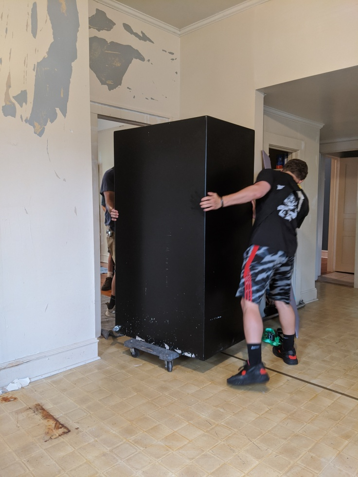 Lifting the safe through the first door