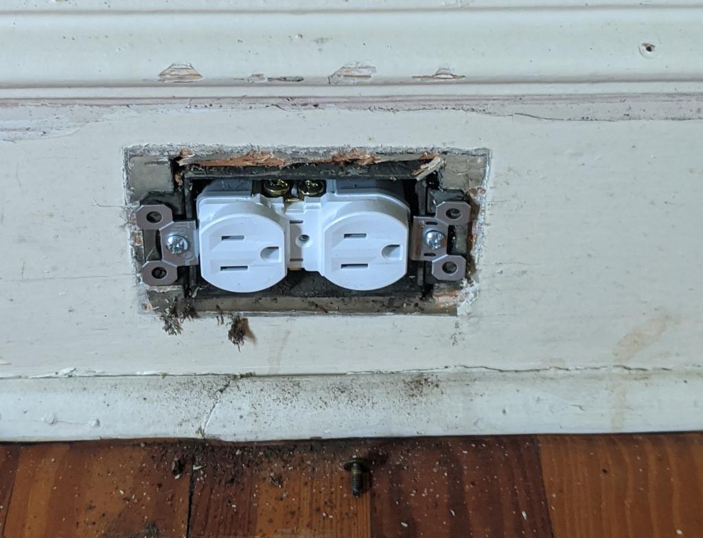 New three-pronged white receptacle